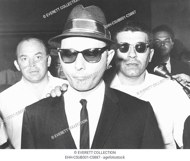 Brooklyn mobster Larry Gallo, arrives at Brooklyn federal court on August 22, 1963. He awaited sentencing for obtaining a $10