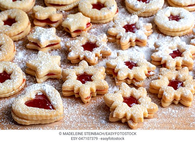 Traditional Linzer Christmas cookies filled with strawberry jam and dusted with sugar