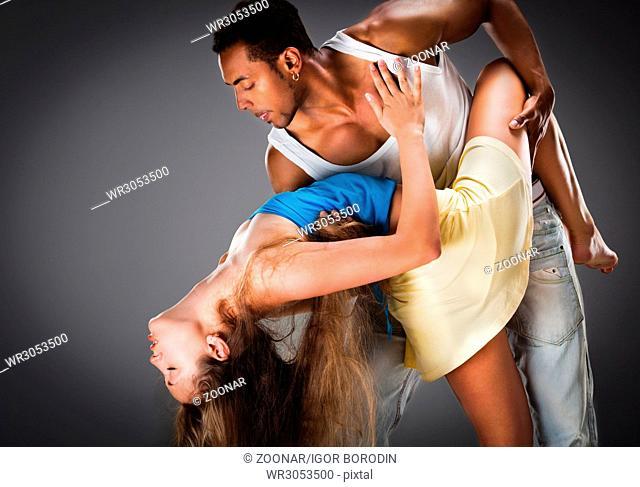 Young couple dances Caribbean Salsa