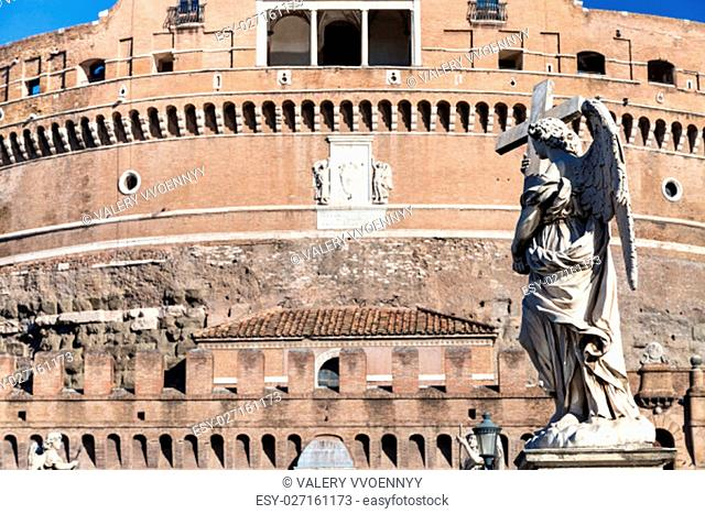 travel to Italy - statue of Angel on bridge Ponte Sant Angelo near Castle of Holy Angel in Rome city