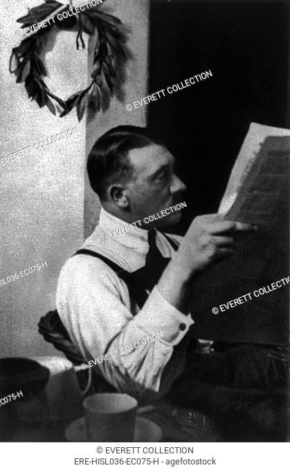 Adolf Hitler reading newspaper in Landsberg prison, 1924. He served nine months for his role in an attempted a coup d'Útat in Munich