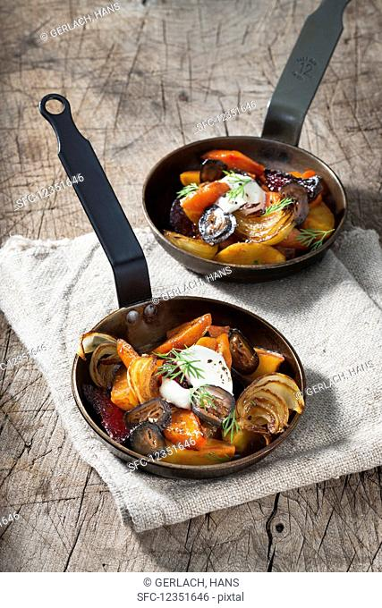 Stewed root vegetables with sour cream and dill