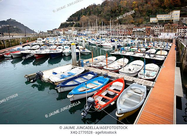San Sebastian, Spain-December 19, 2014: All boats waiting a good weather to set sail in harbour boats in Donosti. Spain
