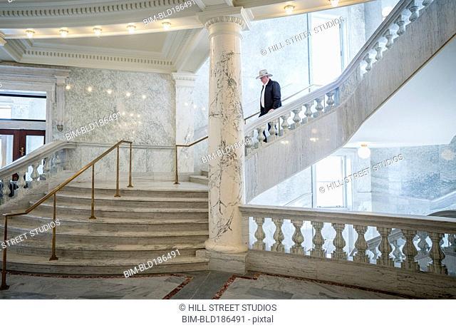 Caucasian man descending stairs in capitol