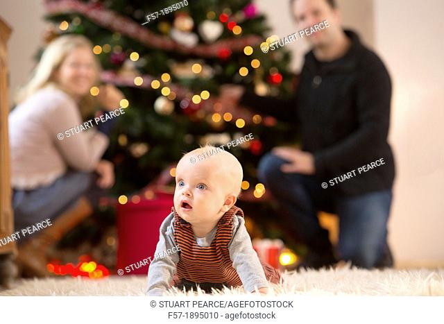 Family with their six month year old baby at Christmas