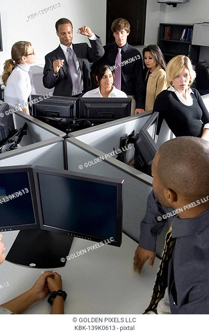 Group of young workers in office working on computers
