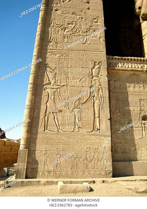 Monumental relief on the left side of the facade of the Temple of Hathor. The Roman Emperor Tiberius in Egyptian dress making ritual offerings to Hathor and Ihy
