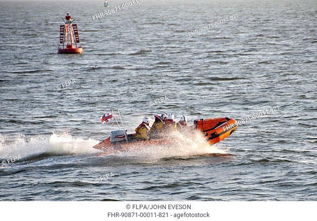RNLI D-class inflatable lifeboat in harbour entrance, Dublin Port, Dublin Bay, Ireland, november