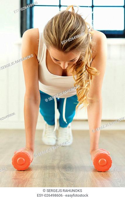 Sport. Beautiful woman in the gym