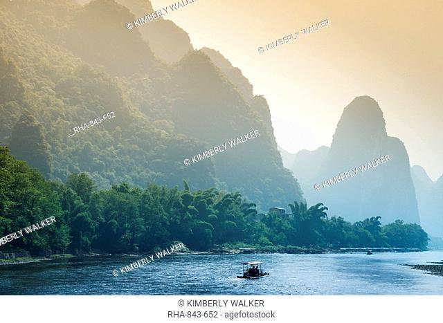 Picturesque countryside scenery along Li River with small boat in water between Guilin and Yangshuo, China, Asia