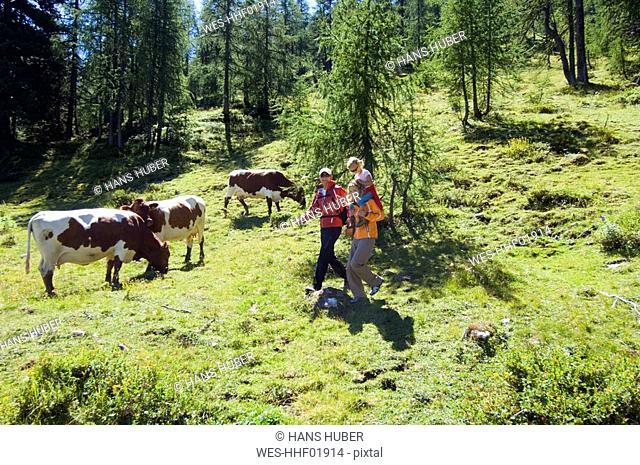 Austria, Salzburger Land, couple with daughter 6-7 hiking