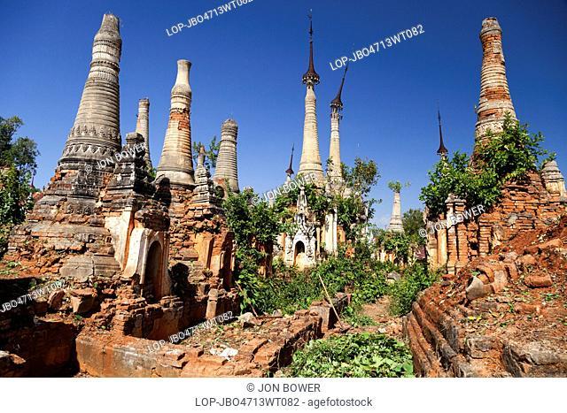 Myanmar, Shan, Shwe Inn Thein. The abandoned and overgrown pagodas of Inn Thein in Myanmar