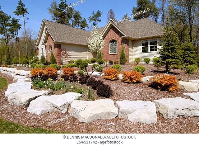 Landscaping surrounding a residential home