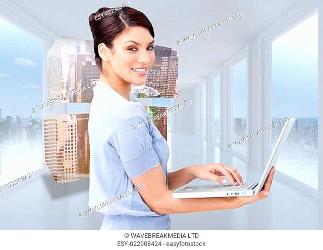 Composite image of cheerful businesswoman using a laptop