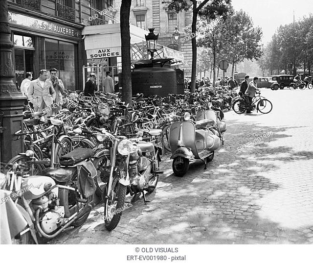 Street scene in Paris, August 23, 1953 All persons depicted are not longer living and no estate exists Supplier warranties that there will be no model release...