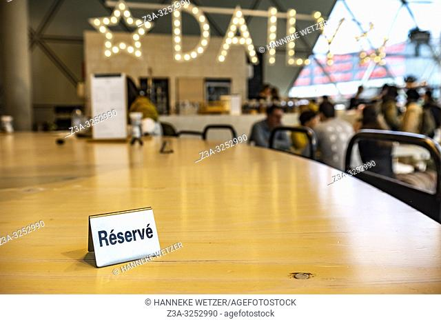 Reserved sign at a wooden table