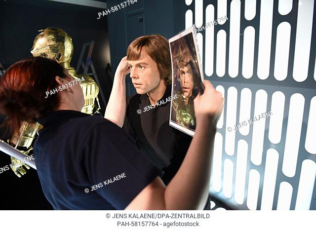 A staff member prepare the wax figure of the Star Wars saga 'Luke Skywalker' in preparation for the world premiere exhibition 'Star Wars at Madame Tussauds' at...