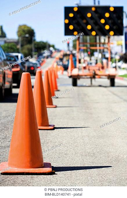 Close up of traffic cones on busy street