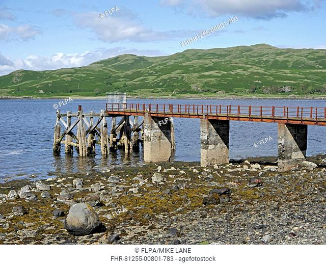 View of jetty on shore of sea loch, Loch Spelve, Firth of Lorn, Isle of Mull, Inner Hebrides, Scotland, July