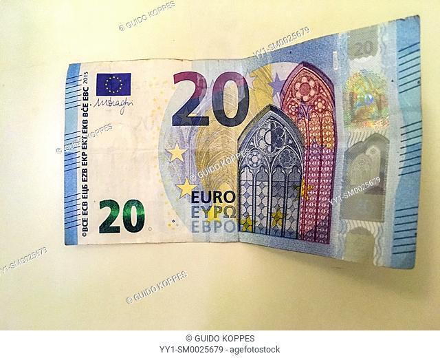 Studio Tuinstraat, Tilburg. A twenty (20) Euro bill glued to an Airbnb guestroom door