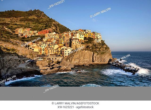 Sea view of Manarola just before sunset with turbulent water along the Cinque Terre region of Italy