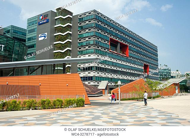 Singapore, Republic of Singapore, Asia - Pedestrians are walking by office buildings at Changi Business Park near the Expo Station