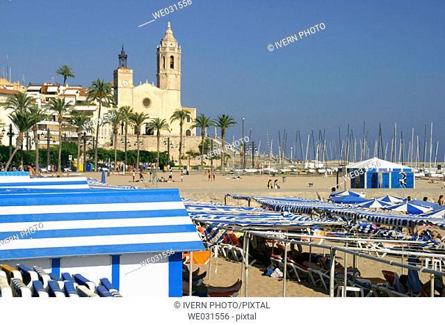 Church of Sant Bartomeu and beach, Sitges. Barcelona province, Catalonia, Spain