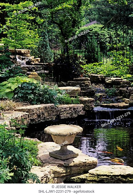 GARDENS: Rock garden, waterfall, Koi pond, urn in foreground