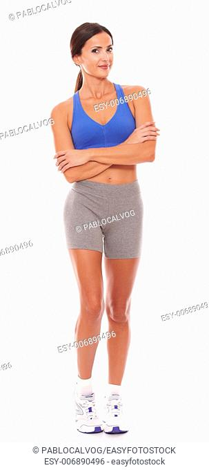 Sporty adult female looking at you taken full length against white background