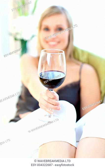 Radiant woman drinking red wine