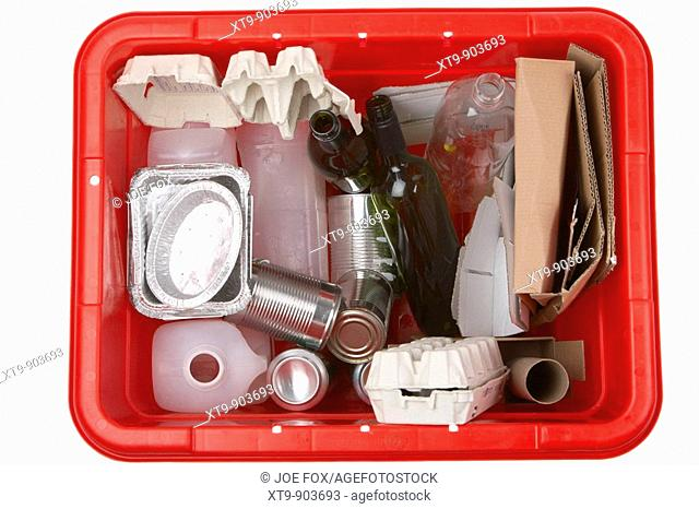 various items of household waste placed in a kerbie kerbside collection bin for recycling including aluminium food containers egg box boxes plastic cartons cans...