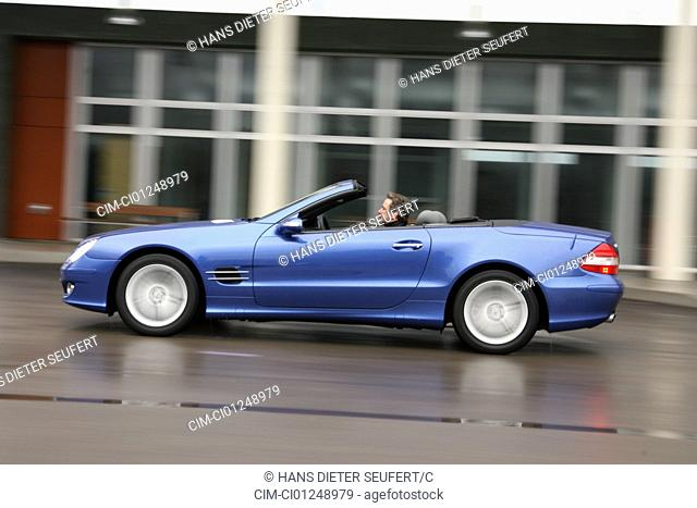 Mercedes SL 500, model year 2005-, blue moving, side view, City, open top