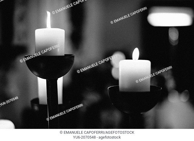 Candelabra with lighted candles in church