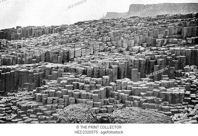 The Giant's Causeway, County Antrim, Northern Ireland, 1924-1926. Legend has it that the Irish giant, Finn McCool, built the Giant's Causeway in order to cross...