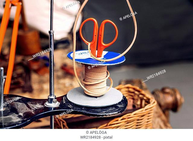 Scissor in rubber spool at bag factory