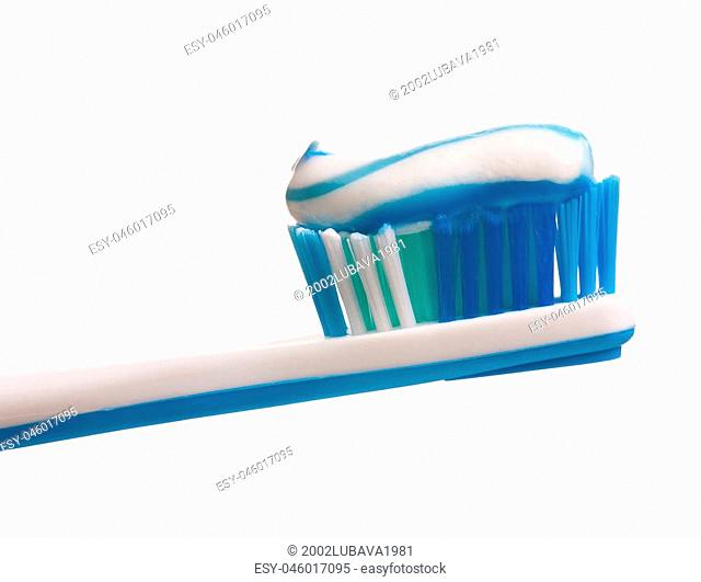 Light-violet toothbrush with toothpaste isolated on white background