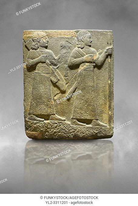 Hittite relief sculpted orthostat stone panel of Royal Buttress. Basalt, Karkamıs, (Kargamıs), Carchemish (Karkemish), 900-700 B C. Warriors