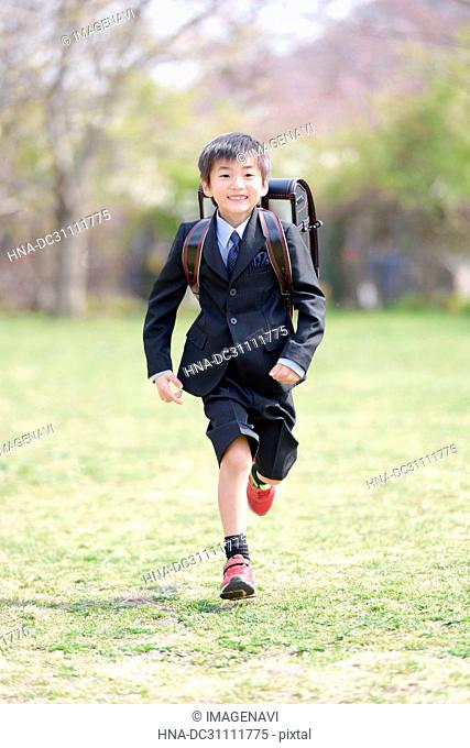 Fresh First Grade Pupil Boy Running in Park