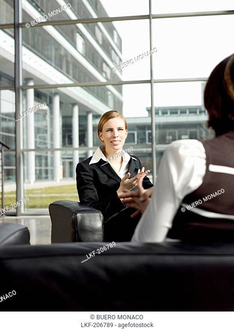 Two businesswomen having a meeting, Munich, Bavaria, Germany