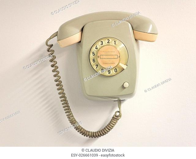 A vintage landline telephone with rotary dial