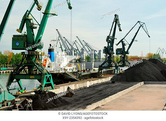 Poland. Port of Gdansk dock facilities. Freighter cargo vessel loading Polish coal at Rudowe Quay in the Gorniczy Basin