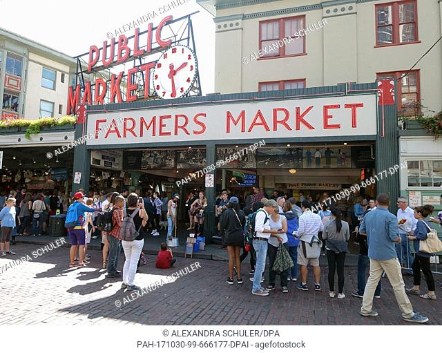 People walk by Pike Place Market in Seattle, US; 30 August 2017. Founded in 1907 by Thomas P. Revelle, the historic Elliot port halls are considered one of the...