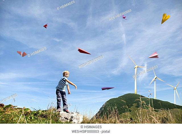 Germany, Bavaria, Boy 4-5 Years playing with paper planes