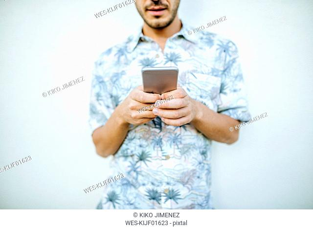 Close-up of man holding cell phone