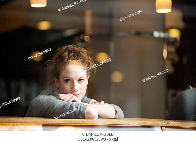 Thoughtful young woman alone in cafe