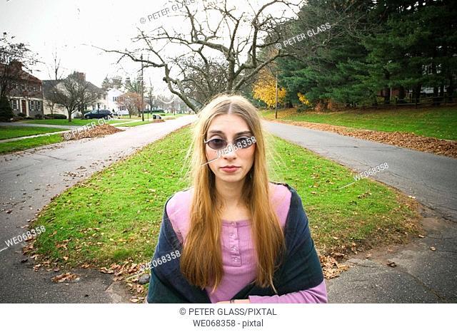 Young woman, wearing sunglasses, posing