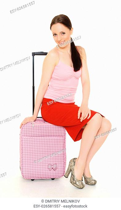 Young happy woman with suitcase on a white background. Vacation
