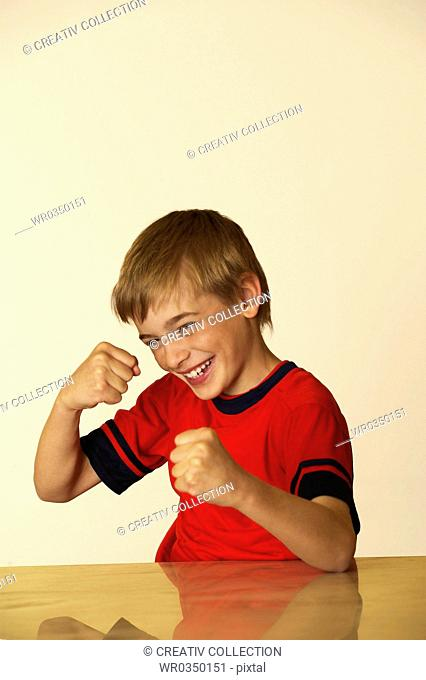 young boy boxing into the air