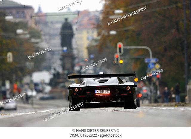 Maserati MC 12 Corsa, model year 2007-, black, driving, diagonal from the back, rear view, City