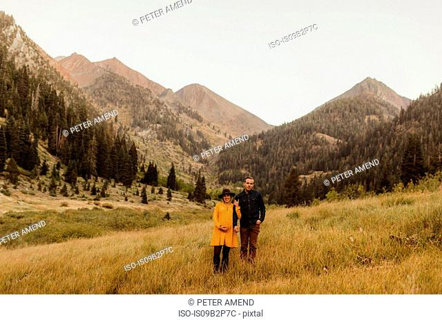 Portrait of couple standing in rural setting, Mineral King, Sequoia National Park, California, USA